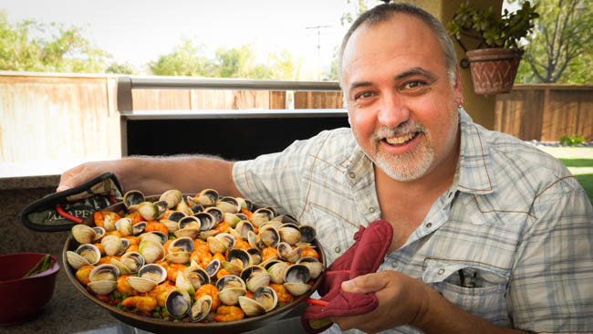 A Happy Chef With His Paella
